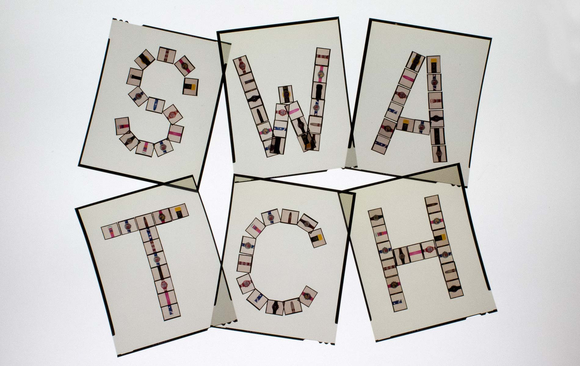"""SWATCH PUZZLE Collection - the name Swatch built with small slides and re-photographed in slide format 4 """"x5"""" - © Graziano Villa"""
